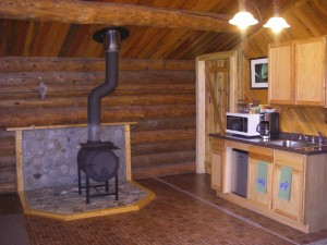 woodstove and kitchenette in Cloudberry Cabin